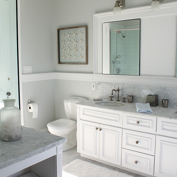 Molly Frey Design - bathrooms - beachy bathroom, beachy master bathroom, seaside bathroom seaside master bathroom, white bathroom cabinets, double bathroom vanity, white double bathroom vanity, marble ocuntertops, double sinks, chair rail, bathroom chair rail, white bathroom mirror, bathroom art, beachy art, beachy bathroom art, beachy bathroom, seaside bathroom, glass shower, marble tiles, marble tile floor, marble bathroom floor, built-ins, bathroom built-ins, bathroom built-in cabinets, Restoration Hardware Dillon Single Sconce,