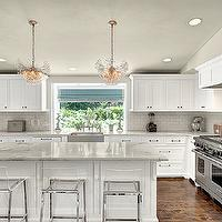 House Crush - kitchens - modern kitchen, sloped ceiling, sloped kitchen ceiling, gray ceiling, blue roman shade, roman shade, picture window, stainless steel apron sink, apron sink, modern barstools, acrylic barstools, modern acrylic barstools, white kitchen cabinets, white kitchen island, ogee edge, ogee edge countertop, beveled subway tiles, beveled subway tile backsplash, beveled subway kitchen tiles, beveled subway backsplash, modern island pendants, wood panel dishwasher, wood dishwasher, kitchen hardwood floors, L shaped kitchen, white kitchen cabinets with white countertops, white kitchen cabinets with marble countertops, CB2 Vapor Barstool,