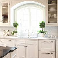 Hendel Homes - kitchens - sink alcove, kitchen sink alcove, arched window, arch window, white kitchen cabinets, shaker cabinets, white shaker cabinets, stacked dishwashers, wood panel dishwashers, white wood panel dishwashers, wood dishwashers, stacked wood dishwashers, topiary, marble countertops, kitchen island, quartz countertops, gray quartz countertop, subway tiles, subway tile backsplash, kitchen subway tiles, subway backsplash, kitchen subway backsplash, kitchen hardwood floors, glass-front cabinets, wood dishwashers, wood paneled dishwashers, stacked dishwashers, wood stacked dishwashers, wood paneled stacked dishwashers,