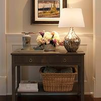 Traditional foyer with light gray walls paint color paired with white wainscoted ...