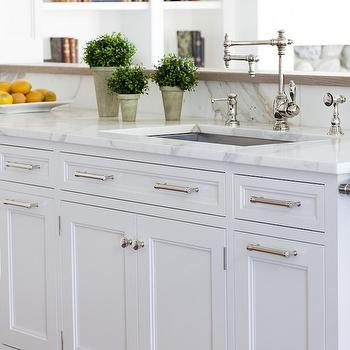 Narrow bathroom floor cabinet - Crisp White Kitchen Cabinets With Marble Countertops And Polished