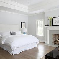 Milton Development - bedrooms - calm bedroom, soothing bedroom, tray ceiling, bedroom tray ceiling, recessed lighting, pale blue bedroom, blue bedroom, pale blue walls, pale blue paint, white headboard, tufted headboard, white tufted headboard, teal table lamps, teal lamps, gourd lamps, teal gourd lamps, gray washed, gray washed bedroom floor, gray washed hardwood floors, gray washed wood floors, bedroom fireplace, fireplace, marble fireplace, fireplace vignette, bedroom fireplace vignette,