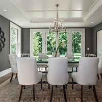 Milton Development - dining rooms - chic dining room, gray dining room, charcoal gray, charcoal gray dining room, charcoal gray walls, charcoal gray paint, dining table, glass-top dining table, black dining table, abacus dining table, black abacus dining table, tufted chairs, tufted dining chairs, white tufted chairs, white tufted dining chairs, chandelier, dining room chandelier, dining room mirror, black dining room, black atom mirror, atom mirror, persian rug, brown persian rug, dining room rug, dining room persian rug, gray rooms, gray walls, velvet chairs, velvet dining chairs, white velvet chairs, white velvet dining chairs, Made Goods Ines Chair,