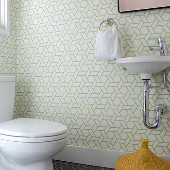 Niche Interiors - bathrooms - yellow woven basket, geometric wallpaper, green geometric wallpaper, white porcelain sink, wall-mount sink, powder room, hex tiles, black hex tiles, black hex tiles, black hex tile floor, modern powder room, modern faucet, manuel canovas wallpaper, trellis wallpaper, green trellis wallpaper, white and green trellis wallpaper, Manuel Canovas Trellis Wallpaper,