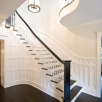 Clawson Architects - entrances/foyers - grand staircase, formal staircase, dark hardwood floors, sweeping staircase, paneled staircase, white spindles, dark  handrail, curved balcony, staircase millwork, staircase wall millwork, curved staircase, grand foyer, grand entrance, foyer, entrance,