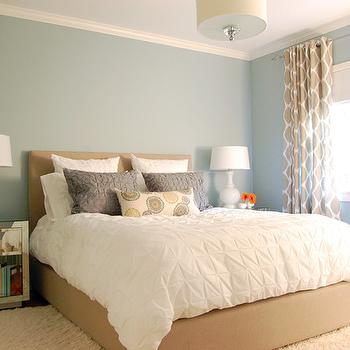 Niche Interiors - bedrooms - blue bedroom, mirrored nightstands, milk glass lamps, white milk glass lamps, milk glass, flokati rug, ivory flokati rug, upholstered bed, gray shams, tan window panels, drum pendants, blue walls, blue paint, blue paint color, blue bedroom walls, blue bedroom paint, blue bedroom paint color, beige and blue bedroom, blue and beige bedroom, beige headboard, beige bed, upholstered headboard, pintuck duvet, pintuck bedding, West Elm Ikat Ogee Linen Window Panel, West Elm Pin-Tuck Duvet, Galbraith & Paul Zinnia, Horchow Shilo Mirrored Chest, Robert Abbey Harriet Glass Lamp,