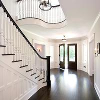 Clawson Architects - entrances/foyers - grand staircase, formal staircase, dark hardwood floors, sweeping staircase, paneled staircase, white spindles, dark  handrail, curved balcony, staircase millwork, staircase wall millwork, curved staircase, foyer lantern, grand formal entrance, foyer, entrance,