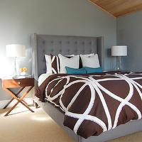 Niche Interiors - bedrooms - vaulted ceiling, wood plank ceiling, blue and gray, blue gray walls, blue gray paint, x-base tables, x-base nightstands, brown bedding, teal, teal pillows, gray bedroom, vignette, gray walls, gray paint, gray headboard, headboard nailhead trim, wingback headboard, gray wing headboard, crystal spire lamps, dahlias, wall to wall carpeting, jute carpeting, wood panel ceiling, tufted wingback headboard, gray tufted wingback headboard, tufted headboard, gray tufted headboard, gray wingback headboard, spire lamps, octagon spire lamps, gray headboard, wingback headboard, white and brown duvet, , Visual Comfort Lighting Medium Octagonal Spire Table Lamp, Dwell Studio Home Gate Duvet, Williams-Sonoma Home Hutton Side Table,