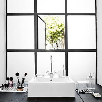 Stylizimo Blog - bathrooms - frosted glass, frosted glass windows, black and white, wood plank bathroom vanity, black wood plank, black wood plank bathroom vanity, rustic bathroom vanity, black bathroom vanity, white porcelain sink, modern sink, square sink, white square sink, gooseneck faucet, acrylic, acrylic bathroom containers, acrylic bathroom cubbies, cubbies, yellow, towel, yellow and black, yellow and black bathroom, sink in front of window, bathroom sink in front of window, yellow accents, black and white bathroom, plank board vanity, plank board bathroom vanity,
