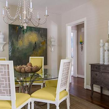EJ Interiors - dining rooms - glass dining table, wall art, mirror, chandelier, , yellow dining chairs, yellow and gray dining chairs, fretwork dining chairs, gray fretwork dining chairs, beaded chandelier,