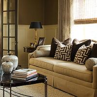 Chic formal living room with brown paint color paired with creamy