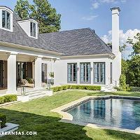 At Home in Arkansas - home exteriors - courtyard, courtyard pool, covered patio, French doors, gray French doors, pool, backyard courtyard,