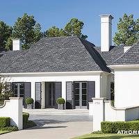 At Home in Arkansas - home exteriors - white stucco, stucco, European, European exterior, European home exterior, his and her, his and her garage, grand home entrance, home entrance,