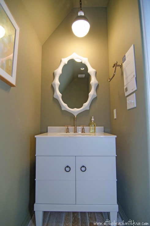 At the Beach with Kris - bathrooms - powder room, gray powder room, white powder room cabinet, modern powder room cabinet, white modern powder room vanity, modern powder room vanity, oval mirror, white oval mirror, Hicks Pendant, powder room pendants, powder room lighting, powder room pendants, powder room hardwood floors, tiny powder room,