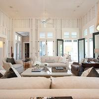 Summer House Style - living rooms - open floor plan, chic living room, transom windows, black doors, linen sofas, ivory linen  sofas, gray chairs, gray slipcover chairs, slipcover chairs, french doors, living room french doors, french doors in living room, transom windows, living room transom windows, transom windows in living room, open airy living room, monochromatic living room,