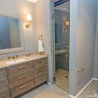 At the Beach with Kris - bathrooms - gray bathroom, gray master bathroom, glass shower, gray glass tiles, gray glass tiles shower, gray subway tiles, gray subway tile shower, gray glass subway tiles, gray glass subway tile shower, gray paint, gray walls, mosaic tiles, brown mosaic tiles, mosaic floor, studded mirror, bathroom sconces, sconces flanking mirror, sconces flanking bathroom mirror, brown bathroom cabinets, inset cabinets, brown inset bathroom cabinets, travertine countertop, gray walls, gray paint, gray paint colors, Bryant Sconce,