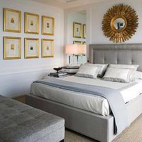 Nuevo Estilo - bedrooms - chic gray bedroom, gray  bedroom, gray headboard, tufted headboard, gray tufted headboard, linen headboard, gray linen headboard, sunburst mirror, gold sunburst mirror, gray bedding, sisal rug, gray bench, tufted bench, gray tufted bench, gold leaf frames, art gallery, blue throw, crystal lamps, grey headboard, grey headboard,