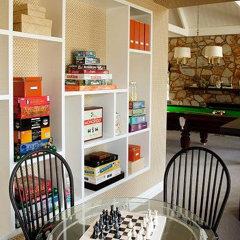 Diane Bergeron Interiors - media rooms - game room, pool table, stone wall, pool table pendant, pool table lighting, white bookshelf, geometric bookshelf, white geometric bookshelf, board games, windsor chairs, black windsor chairs, glass table, game table, glass game table, retro game room, retro basement game room,