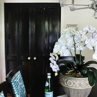 The Hunted Interior - dining rooms - glossy black doors, black doors, dining room chandelier, black  dining table, rectangular dining table, teal blue, teal blue chairs, teal blue fretwork, fretwork, black and blue dining room, blue and black dining room, glossy black doors,