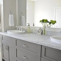 Veranda Interiors - bathrooms - gray bathroom, double bathroom cabinet, double bathroom vanity, gray double bathroom vanity, shaker cabinets, gray shaker cabinets, gray bathroom cabinets, frameless mirror, bathroom sconces, frosted glass sconces, oval sinks, white vessel sinks, marble countertop, gray bathroom cabinets, gray cabinets, gray bathroom vanity, gray bathroom vanities,