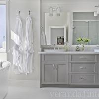 Veranda Interiors - bathrooms - gray bathroom, double bathroom cabinet, double vanity, gray double vanity, shaker cabinets, gray shaker cabinets, gray bathroom cabinets, frameless mirror, bathroom sconces, frosted glass sconces, modern tub, freestanding tub, oval sinks, white vessel sinks, marble countertop, contemporary gray bathrooms, gray master bathrooms, gray bathroom vanity, gray cabinets,