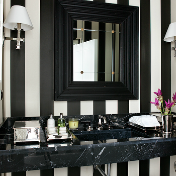 Luis Bustamante - bathrooms - black and white, black and white bathroom, stripe walls, vertical stripe walls, black beveled mirror sconces flanking mirror, marble bathroom vanity, black marble bathroom vanity, floating vanity, black floating vanity, black marble floating vanity, min julep vase, powder room,