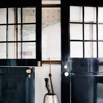 Thomas O'Brien - entrances/foyers - dutch doors, black dutch doors, glossy black doors, glossy black dutch doors, umbrella stand, world map,