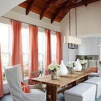 Tracery Interiors - dining rooms - seaside dining room, vaulted ceiling wood beams, salmon pink, salmon pink curtains, silk drapes, salmon pink drapes, salvaged wood dining table, tapered bench, bench nailhead trim, storage bench. captain chairs, slipcover chairs, slipcover captain chairs, slate tiles, slate floor, slate tile floor, dining room pendant, dining room lighting, white gourd vase, French cafe chairs, captain chairs, wingback captain chairs, reclaimed wood table, reclaimed wood dining table,