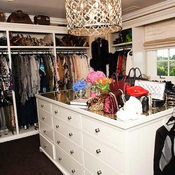 The Coveteur - closets - walk-in closet, glam closet, glamorous closet, closet island, mirrored-top closet island, quatrefoil pendant, gold quatrefoil pendant, closet lighting, island pendant, built-ins, closet built-ins, closet cabinets, closet built-in cabinets, Louis Vuitton, Khloe Kardashian, closet island, mirror top closet island, closet island with mirro top, closet island with mirrored top, Ironies Asilah Chandelier,
