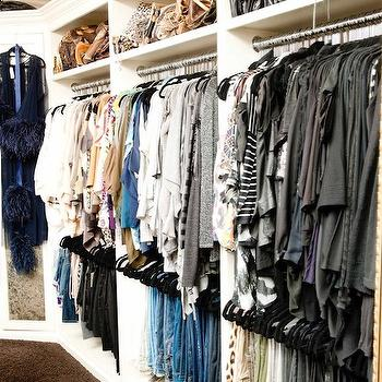 The Coveteur - closets - bag racks, bag nooks, walk-in closet, glam closet, glamorous closet, built-ins, closet built-ins, closet cabinets, closet built-in cabinets, Louis Vuitton, Khloe Kardashian, luxurious closet, luxurious walk in closet,