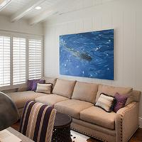 Anne Sneed Architectural Interiors - living rooms - plantation shutters, sectional sofa, chaise lounge, beige sectional sofa, beige sectional, bamileke stool, brown bamileke stool, cowhide rug, purple pillows, vaulted ceiling, wood panles, white wood panels, white wood paneled walls, white wood paneling, sectional, sectional sofa, studded sectional, studded sectional sofa,