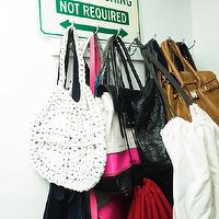 The Coveteur - closets - walk-in closet, bag rack, closet art, closet bag rack, closet purse rack,  Stacy London - Walk-in closet with bag rack.