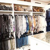 The Coveteur - closets - walk-in closet, glam closet, glamorous closet, closet island, mirrored-top closet island, built-ins, closet built-ins, closet cabinets, closet built-in cabinets, Louis Vuitton, Khloe Kardashian, khloe kardashian closet, luxurious closet, luxurious walk in closet,