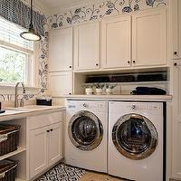 Farinelli Construction - laundry/mud rooms - cream and blue, cream and blue laundry room, valance, blue valance, white shelves, utility sink, cream cabinets, cream laundry room cabinets, shaker cabinets, cream shaker cabinets, woven baskets, white front-load washer and dryer, laundry room shelving, laundry room shelves,