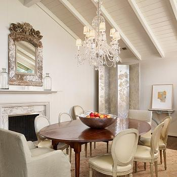 Dillon Kyle Architecture - dining rooms - ornate mirror, marble fireplace, oval dining table, oval back chairs, captain chairs, slipcover captain chairs, metallic floor screen, metallic folding screen, vaulted ceiling, beadboard ceiling, fireplace in dining room, dining room fireplace,