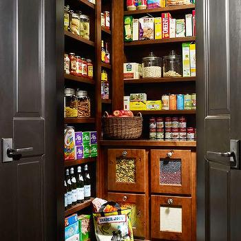 BHG - kitchens - walk-in pantry, black walk-in pantry, ebony floors, ebony wood floors, ebony hardwood floors, bi-fold doors, bi-fold pantry doors, double doors, black double doors, vintage pantry, storage bins, food bins, grain bins, vintage pantry, vintage walk in pantry, black bi fold doors,