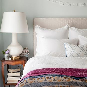 Design Sponge - bedrooms - pale gray paint, pale gray walls, white gourd lamp, cream headboard, fuchsia blanket,  Zoe Johns and Max Catalano