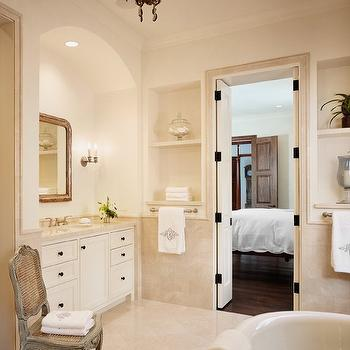 Dillon Kyle Architecture - bathrooms - arched miror, cane chair, gray cane chair, bi-fold doors, elegant bathroom, freestanding tub, wall-mount tub filler, niche, arched alcove, built-in vanity, crema marfil, crema marfil marble, crema marfil marble counters, crema marfil marble countertops, crema marfil tile bathroom, crema marfil bathroom tiles, crema marble tiles, crema marble, crema marble floor, crema marble backsplash, crema marfil marble tiles, crema marfil marble floor, crema marfil marble backsplash, crema marble countertops, crema marfil marble bathroom, crema marfil tile bathroom,