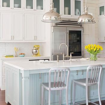 BHG - kitchens - industrial stools, yoke pendants, industrial pendants, island pendants, kitchen pendants, glass-front fridge, two-tone kitchen, two-tone kitchen cabinets, two-tone cabinets, turquoise blue, turquoise blue kitchen island, beadboard panels, sink in kitchen island, marble countertops, bridge faucet, white kitchen cabinets, shaker cabinets, white shaker cabinets, kitchen hardwood floors, turquoise kitchen island, beadboard kitchen island, blue beadboard kitchen island, Crate & Barrel Delta Barstool, Restoration Hardware Harmon Pendant,
