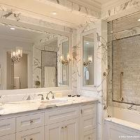 Dillon Kyle Architecture - bathrooms - marble bathroom, bathroom sink alcove, drop-in tub, wood panel tub, glass shower door, glass shower partition, shower partition, sliding shower partition, sliding glass shower partition, double bathroom vanity, white bathroom cabinets, shaker cabinets, white shaker cabinets. marble countertops, white framed mirror, double sinks, oval sinks, bathroom sconces, carrara marble, carrara marble shower, carrara marble suwbay tiles, carrara marble subway tiles shower, carrara marble shower, carrara marble shower surround,