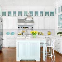 BHG - kitchens - u shaped kitchen, turquoise blue lined cabinets, turquoise blue shelves, industrial stools, yoke pendants, industrial pendants, island pendants, kitchen pendants, glass-front fridge, two-tone kitchen, two-tone kitchen cabinets, two-tone cabinets, turquoise blue, turquoise blue kitchen island, beadboard panels, sink in kitchen island, marble countertops, bridge faucet, white kitchen cabinets, shaker cabinets, white shaker cabinets, kitchen hardwood floors, turquoise kitchen island, white and turquoise kitchen, white and turquoise blue kitchen, Crate &amp; Barrel Delta Barstool, Restoration Hardware Harmon Pendant,