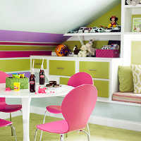 Kara Cox Interiors - girl's rooms - colorful playroom, play room, playroom, attic playroom, attic play room, sloped ceiling, multi-stripe walls, built-in window seat, window seat, hot pink chairs, plastic chairs, pink plastic chairs, trellis pillows, green trellis pillows, attic girls play room, attic girls playroom, P Kaufmann Slick, Ikea Docksta Table,