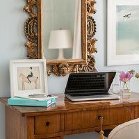 Design Sponge - dens/libraries/offices - ornate mirror, gilt mirror, gilt ornate mirror, blue paint vintage desk, desk, ornate gilt mirror,