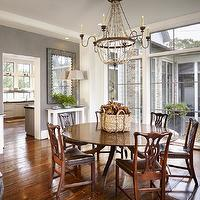 Dillon Kyle Architecture - dining rooms - gray paint, gray walls, round dining table, chippendale chairs, iron chandelier, beaded chandelier, floor to ceiling windows, traditional chippendale chairs,