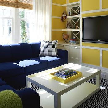 Lynn Morgan Design - media rooms: yellow and blue, yellow and blue family room, yellow paint, yellow walls, cobalt blue, cobalt blue sectional, cobalt blue sofa, coffee table, white parsons coffee table, black and white, black and white rug, fretwork rug, family room, family room built ins, family room built in cabinets, built ins for family room, built in cabinets for family room,