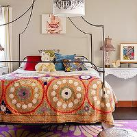 The Novogratz - girl's rooms: whimsical girl's room, chandelier drum pendant, canopy bed, iron bed, iron canopy bed, rococo tables, white rococo tables, purple and gold, purple and gold rug, purple rug, suzani blanket moroccan pouf, silver moroccan pouf, tan walls, tan paint, campaign bed, iron campaign bed,
