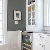 Normandy Remodeling - kitchens: wine cooler, glass-front cabinets, kitchen hardwood floors, charcoal gray paint, Caesarstone countertops, quartz countertops, Caesarstone pebble countertops, white kitchen cabinets, shaker cabinets, white shaker cabinets, kitchen wainscoting, charcoal gray walls, charcoal gray paint, charcoal gray paint color,
