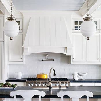 Boston Magazine - kitchens - blue ceiling, blue painted ceiling, swing-arm pot filler, kitchen island, breakfast bar, white barstools, seagrass barstools, beachy kitchen, u shaped kitchen, beadboard backsplash, white beadboard backsplash, soapstone countertops, wood kitchen hood, beehive pedants, island pendants, kitchen lighting, kitchen pendants, white kitchen cabinets, shaker cabinets, white shaker cabinets, soapstone islands, soapstone kitchen islands, soapstone on islands, soapstone on kitchen islands, honed soapstone, honed soapstone counters, honed soapstone countertops, beadboard ceiling, beadboard kitchen ceiling, blue beadboard ceiling, blue ebadboard kitchen ceiling, Robert Abbey Beehive Pendant, Benjamin Moore Decorators White, Pottery Barn Napoleon Barstool,