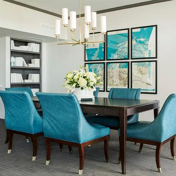 Tobi Fairley - dining rooms - gray moldings, acrylic barstools, lucite barstools, gray built-ins, peacock blue, peacock blue chairs, peacock blue dining chairs, swoop arm chairs, velvet chairs, blue velvet chairs, brass chandelier, dining room chandelier, vintage map, turquoise blue map, art gallery, teal dining rooms, peacock blue dining rooms, peacock blue dining room, Ziyi Large Chandelier,