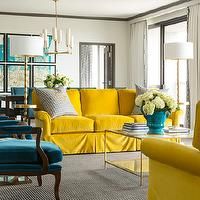 Tobi Fairley - living rooms - canary yellow, canary yellow sofas, rolled-arm sofa, yellow rolled-arm sofa, peacock blue chairs, peacock blue bergere chairs, bergere chairs, velvet chairs, blue velvet chairs, brass floor lamps, turquoise blue, turquoise blue planter, coffee table, glass-top coffee table, gray moldings, teal living rooms, canary yellow living rooms, yellow living rooms, teal and yellow living rooms, yellow and blue living room, yellow and peacock blue living room, peacock blue and yellow living room, yellow sofas, velvet sofas, yellow velvet sofas,